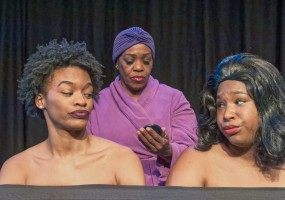 From left to right: Paige Mayes, Clara McDaniel, and Tavia Percia (straight wig) in The Hairpiece, a vignette in George C. Wolfe's The Colored Museum at the African-American Shakespeare Company