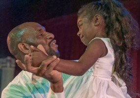 Cinderella's Father (Todd Risby) and Young Cinderella (Brazil Johnson) dance with each other in African-American Shakespeare Company's 2014 production of Cinderella.