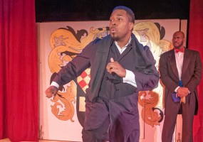 Rebelious Prince Charming (Anthone Jackson) desires to be normal with the Duke (Todd Risby) monitoring His Royal Highness unprotocol behavior in African-American Shakespeare Company's 2014 production of Cinderella.
