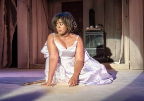Cinderella's dress (Regina Fields) is ripped to shreds and she is unable to attend the ball in African-American Shakespeare Company's 2014 production of Cinderella.