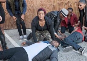 Tigs (Ryan Nicole Austin) witness the latest shooting of her brother E-Mem (Aejay Mitchell); while LeRoi (Howard Johnson); Old Blind Woman (Awele Makeba) and Fay (Jasmine Strange) over the death of a child (Cadence Strange)