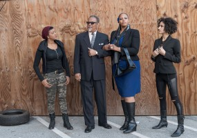 Left to right: Tigs (Ryan Nicole Austin) looks to the political leaders in power Uncle Marcellus (Robert Fisher) and his wife Fay (Jasmine Strange) to solve the gun problems of their community with the assistance of Tea Flake (Naima Shalhoub)