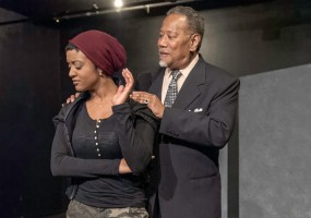Marcellus (Robert Fisher) tries to reason with Tigs (Ryan Nicole Austin) in African-American Shakespeare Company's World Premiere of Nambi E. Kelley's Xtigone