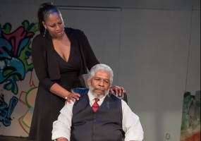Fay (Jasmine Strange) comforts her husband, Mayor Marcellus (Dwight Mahabir) about the new law to cover the problems of the city by burying its problems. Photo Credit: Lance Huntley