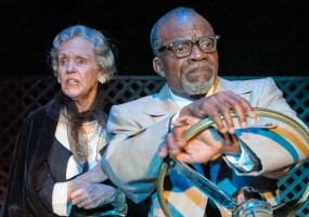 Hoke (L. Peter Callender) drives Miss Daisy (Ann Kendrick) to a special event.
