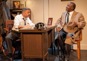 Boolie (Timothy Beagley) interviews Hoke (L. Peter Callender) for the job as Miss Daisy's chauffeur.