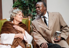 Hoke (L. Peter Callender) brings coffee to Miss Daisy (Ann Kendrick) during a power failure in Atlanta.